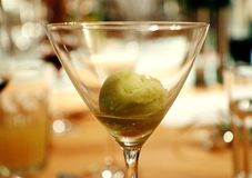 Sorbet lime and basil, delicious!. Sorbet lime and basil as dessert with blurred background and bokeh effects Royalty Free Stock Image