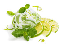 Sorbet of lime. Ice cream of lime decorated with zest and mint isolated on white background stock images