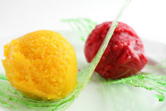 Sorbet from orange and strawberry Stock Photos