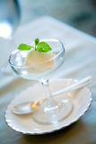 The sorbet is served. A scoop of sorbet ice cream is served in a glass cup royalty free stock photos