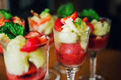 Sorbets in glasses. Lychee and elderberry flowers and strawberry sorbet Royalty Free Stock Image