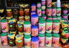 Sorbets at jar. Of different flavors and vegetable stew zacusca at traditional product fair Royalty Free Stock Photos