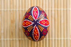 Sorbian easter egg on bamboo background. Top view stock photo