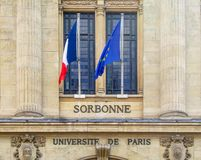 Sorbonne, universite de Paris meaning university of Paris written on a wall with the French and European flags. Sorbonne, universite de Paris meaning university Royalty Free Stock Photo