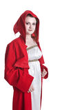 Sorcerer. Girl sorcerer wearing red robe isolated on white royalty free stock images