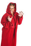 Sorcerer. Girl sorcerer wearing red robe isolated on white stock photos