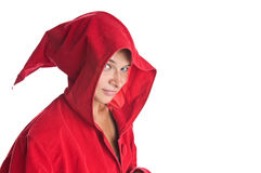 Sorcerer. Girl sorcerer wearing red robe isolated on white stock images