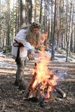 Sorcerer. Russian sorcerer near a fire in wood on a glade royalty free stock image