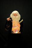 Sorcerer. With crystal ball pointing at viewer royalty free stock images