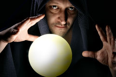 Sorcerer. With glowing magical sphere close-up stock photos