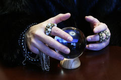 Sorcerer hands over a transparent crystal ball fortune-telling for future. Sorcerer hands over a transparent crystal ball fortune-telling for the future Royalty Free Stock Photo