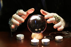 Sorcerer hands over a transparent crystal ball fortune-telling for future royalty free stock image