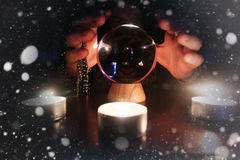 Sorcerer hands over a transparent crystal ball fortune-telling for future. Sorcerer hands over a transparent crystal ball fortune-telling for the future Stock Photo
