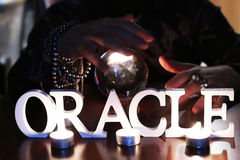 Sorcerer hands over a transparent crystal ball fortune-telling for future. Sorcerer hands over a transparent crystal ball fortune-telling for the future Stock Image