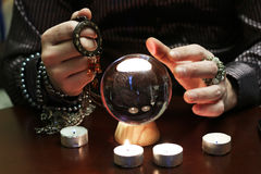 Sorcerer hands over a transparent crystal ball fortune-telling for future. Sorcerer hands over a transparent crystal ball fortune-telling for the future Royalty Free Stock Images