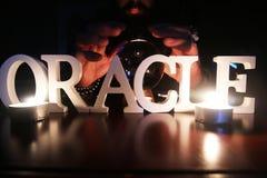 Sorcerer hands over a transparent crystal ball fortune-telling for future. Sorcerer hands over a transparent crystal ball fortune-telling for the future Stock Images