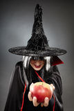 Sorcerer offering a poisoned apple Stock Photo