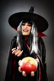 Sorcerer offering a poisoned apple Stock Images