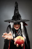 Sorcerer offering a poisoned apple Royalty Free Stock Photo