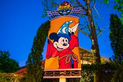 Sorcerer`s apprentice Mickey  sign on blue night background at Walt Disney World . royalty free stock photo