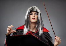Sorcerer with a wand Stock Photography