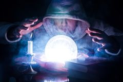 Sorcerer who predicts destiny with glowing magic ball royalty free stock photos