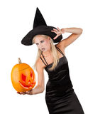 Sorceress. Beautiful sorceress with pumpkin. isolated on white background royalty free stock images