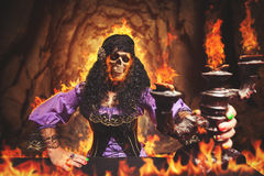 Sorceress burning away. Sorceress is burning away, she has skull instead of her face Royalty Free Stock Images