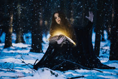 Sorceress celebrating the magic. Of the magic books stock images