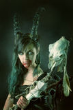 Sorceress. Faun sorceress with big horns and blood against a dark background stock images