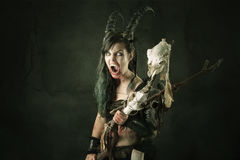 Sorceress. Faun sorceress with big horns and blood against a dark background royalty free stock image