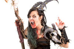 Sorceress. Faun sorceress with big horns and blood isolated in white stock photography