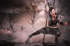 Sorceress. Faun sorceress with big horns in a dry forest royalty free stock photo
