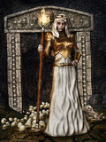 Sorceress at the gate with skulls. Fantasy sorceress with a torch at a gate with skulls Stock Photo