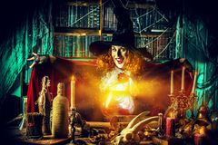 Sorceress lady. Attractive witch in the wizarding lair. Fairytales. Halloween Stock Images