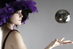 Sorceress levitating a silver globe. Woman dressed up as a sorceress levitating a silver globe Stock Photos