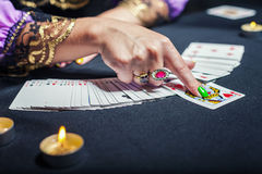 Sorceress telling fortunes. Close up of sorceress telling fortunes using cards Stock Photo