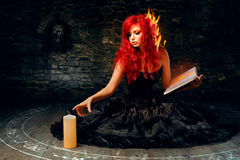 Sorceress trying to create fire. Sorcerry lesson of creating fire Royalty Free Stock Photography