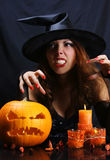 Sorcery. Young witch on halloween night Royalty Free Stock Images