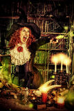 Sorcery magician. Attractive witch in the wizarding lair. Fairytales. Halloween stock image
