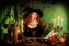 Sorcery woman. Attractive witch in the wizarding lair. Fairytales. Halloween Royalty Free Stock Photos