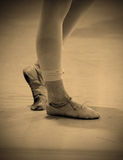 Sore and battered ballet dancer's feet. With bandaged and beat-up shoes stock photo