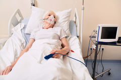 Sore feeble lady feeling much better. Neat treatment. Unstable ill senior woman suffering from a heart attack and being delivered in hospital while her condition royalty free stock images