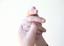 Sore fingers flexed stock images
