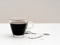 Sore head breakfast - black coffee and aspirin, painkillers. Hangover morning. Cup of strong black coffee with aspirins or similar royalty free stock photography