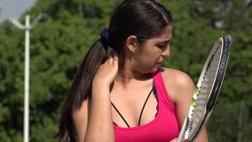 Sore Injured Athletic Female Teenage Tennis Player. A young female hispanic teen stock video