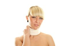 Sore neck. Young attractive woman with an elastic bandage around his neck. Discomfort. Isolated Royalty Free Stock Photography