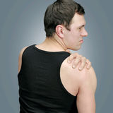 Sore shoulder. Depicts a young man pain royalty free stock photos