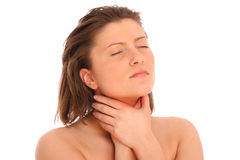 Sore throat. A picture of a young woman suffering from sore throat over white background Stock Photos