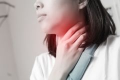 Sore throat of a asian women. Touching the neck. Sore throat of a asian women. Touching the neck royalty free stock photos